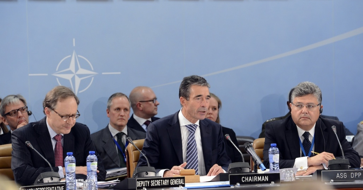 NATO Secretary General Anders Fogh Rasmussen (C) sits prior to the start of the Oct. 9, 2012 NATO Defense Ministers meeting at NATO headquarter in Brussels. Rasmussen warned Tuesday against the dangers of the conflict in Syria escalating, saying alliance member Turkey had shown commendable restraint in response to shelling of its border area.</p>