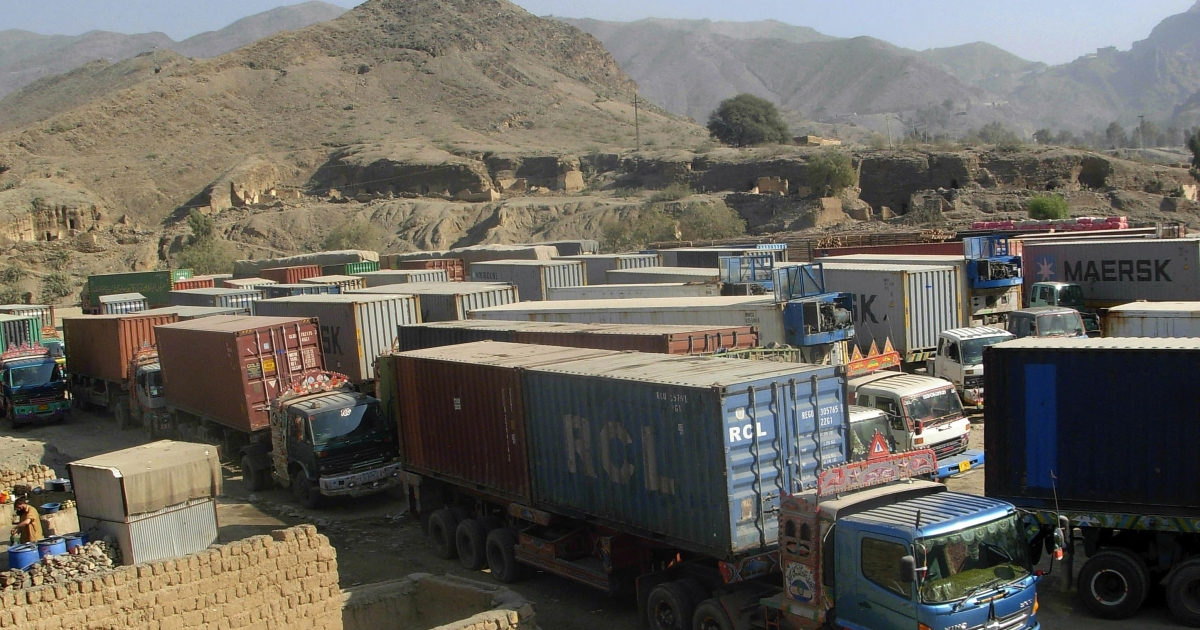 Trucks carrying supplies for NATO forces in Afghanistan are parked at the Pakistan's Torkham border crossing after Pakistani authorities suspended NATO supplies on November 26, 2011.</p>
