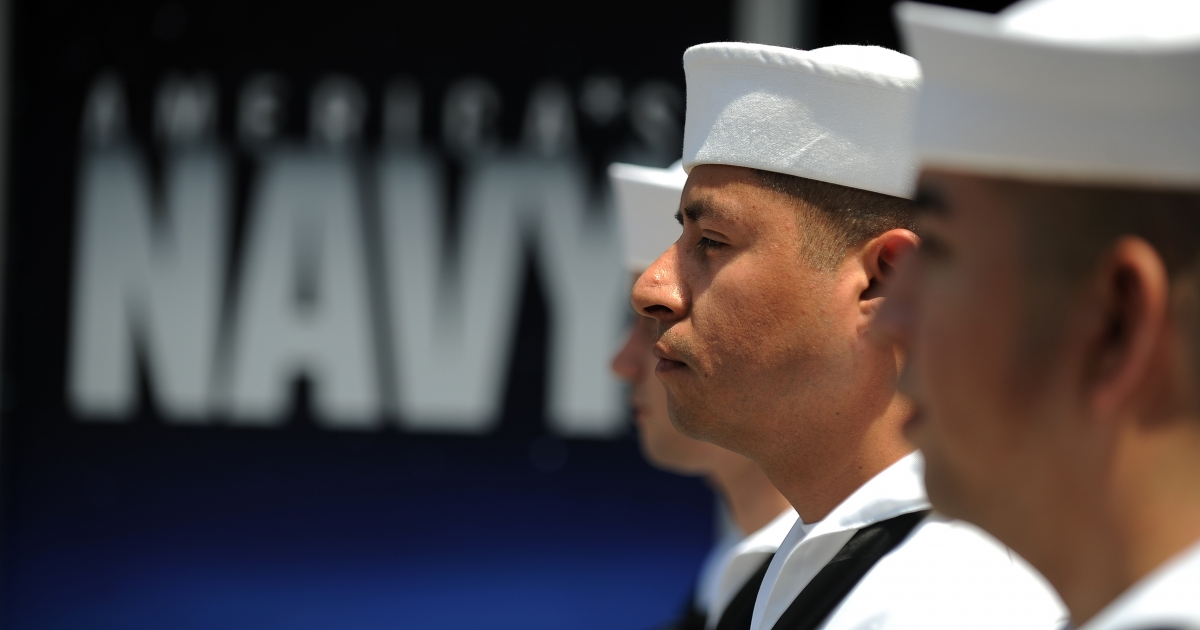 US Navy sailors await the start of their re-enlistment ceremony in Los Angeles on July 28, 2011.</p>