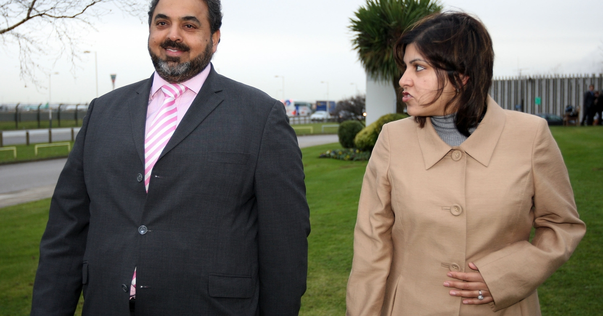 Lord Ahmed talks with Baroness Warsi on arrival from Sudan at London Heathrow Airport in December, 2007.</p>