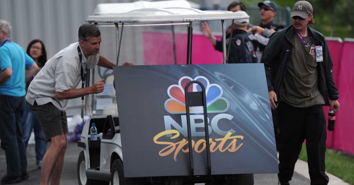 An NBC Sports poster board is unloaded from a buggy at the London 2012 Olympic Park, east London, on July 21, 2012.</p>