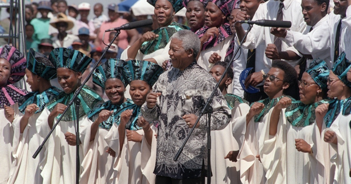President Mandela celebrates the signing of South Africa's new constitution, on Dec. 10, 1996, in Sharpville stadium. The constitution is considered one of the most progressive in the world.</p>