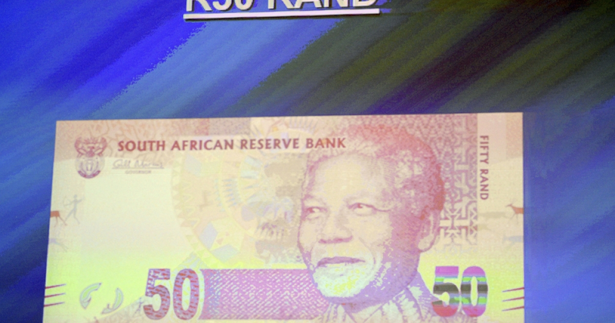 This picture taken on February 11, 2012 shows the new South African bank note of 50 Rand displayed on a screen during the announcement of a new line of bank notes in Pretoria. The new bank notes bear the former president's image Nelson Mandela circa 1990, the year he was freed from prison in a moment that came to symbolise the fall of apartheid and the rise of a new, democratic South Africa. They replace a design featuring the 'big five' safari animals (Cape buffalo, elephant, leopard, lion and rhino) introduced in 1992, two years before Mandela was elected the country's first black president.</p>