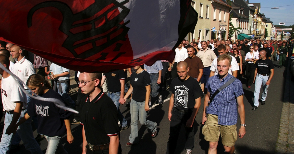 Neo-Nazis march under a flag bearing the colors of pre-World War II Germany August 16, 2003 through Wunsiedel, Germany to commemorate the anniversary of the death of Rudolf Hess, deputy to Adolf Hitler. About 2,600 neo-Nazis from across Europe, including Germany, Great Britian, Italy, Holland, Slovakia, Bulgaria, Austria and the Czech Republic, marched to pay their respects to Hess, until this week buried in Wunsiedel.</p>