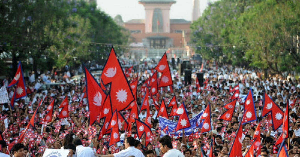 Nepalese people gather for a mass meeting to express their social harmony and the punctual implementation of a new constitution in Kathmandu May 23, 2012.  Nepal Supreme Court gave a deadline to draw up a new constitution for the Himalayan nation till Sunday May 27, 2012.</p>
