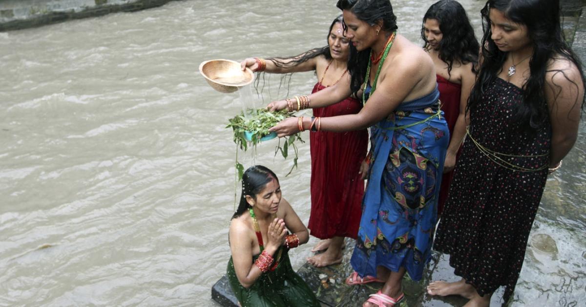 Nepalese Hindu women take a ritual bath in the Bagmati River during the Rishi Panchami festival in Kathmandu.</p>