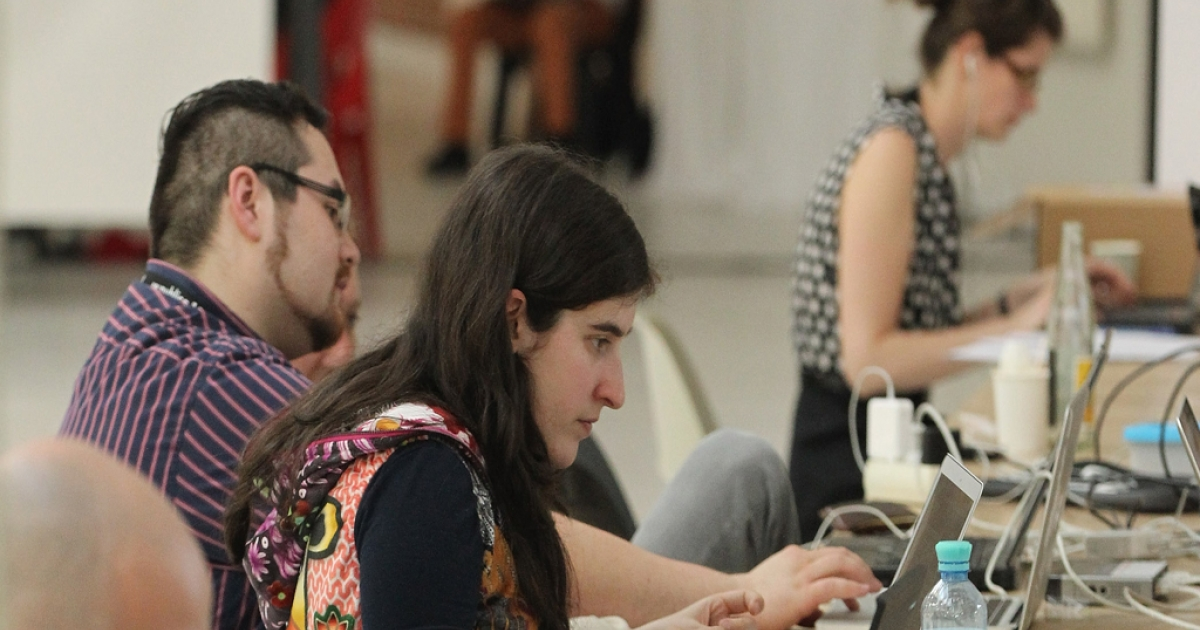Participants sit at computers and other digital devices between sessions during the 2012 re.publica conferences on May 2, 2012 in Berlin, Germany.</p>