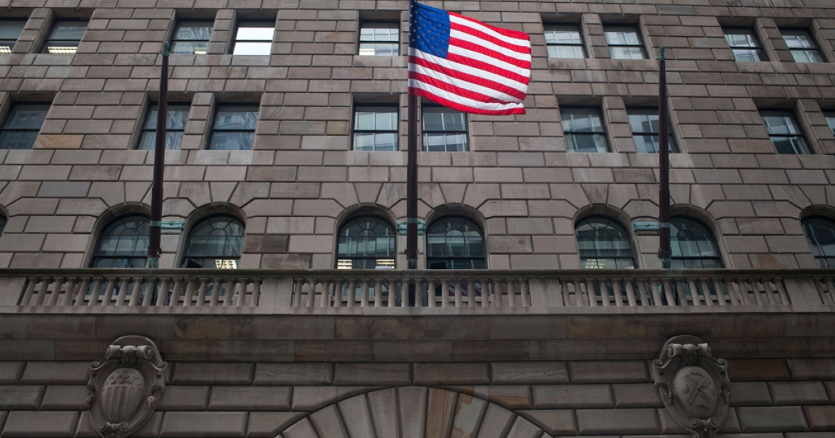 A US flag flies over the entrance to the Federal Reserve Bank of New York on July 29, 2011. A Bangladeshi native was arrested Oct. 17, 2012, in an alleged plot to blow up the building, authorities say.</p>