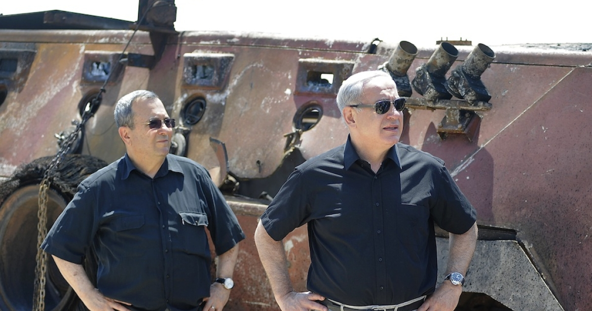 Israeli Defence Minister Ehud Barak (L) and Prime Minister Benjamin Netanyahu (R) stand next to a burnt armoured vehicle near the Kerem Shalom border crossing after unidentified gunmen crossed into Israel from Egypt on August 6 , 2012.</p>