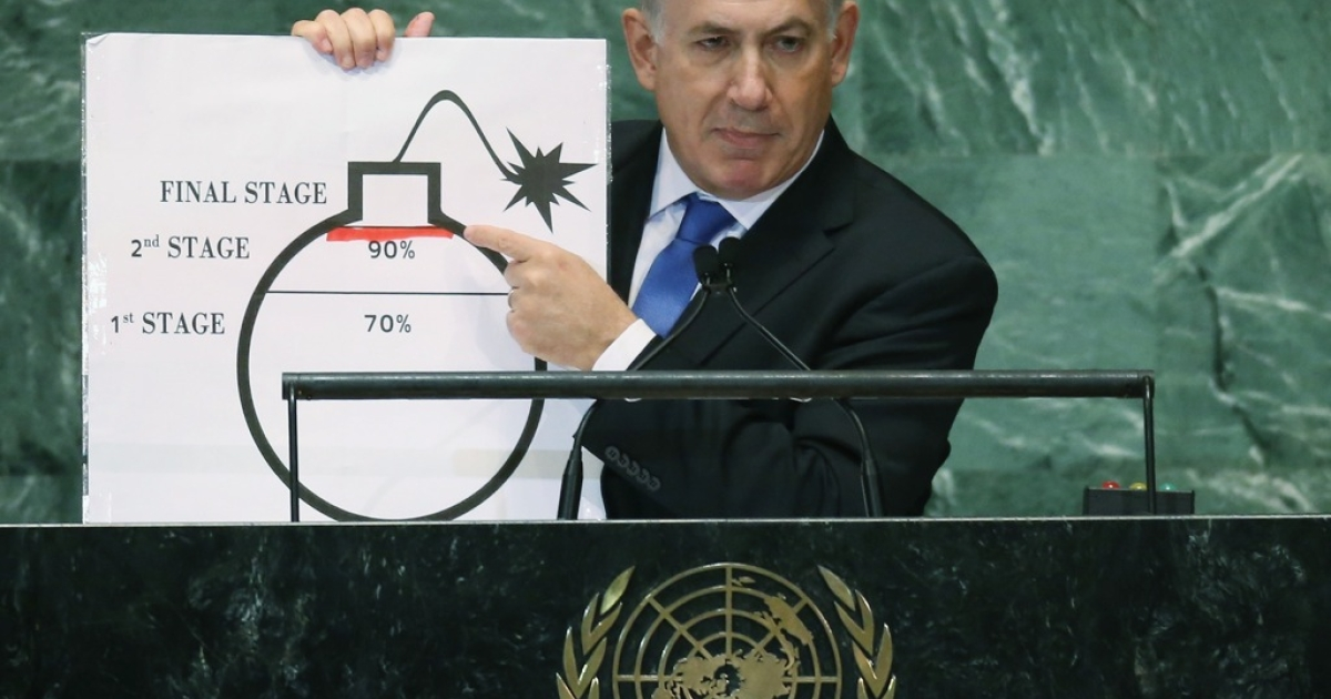 Prime Minister of Israel Benjamin Netanyahu points to a red line he drew on a graphic of a bomb while addressing the United Nations General Assembly on September 27, 2012 in New York City.</p>