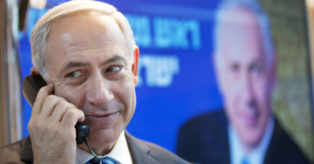 Israeli Prime Minister Benjamin Netanyahu speaks on the phone with potential voters ahead of the upcoming Israeli elections on January 17, 2013. in Tel Aviv, Israel. Israeli elections are scheduled for January 22 and so far showing a majority for the Israeli right.</p>