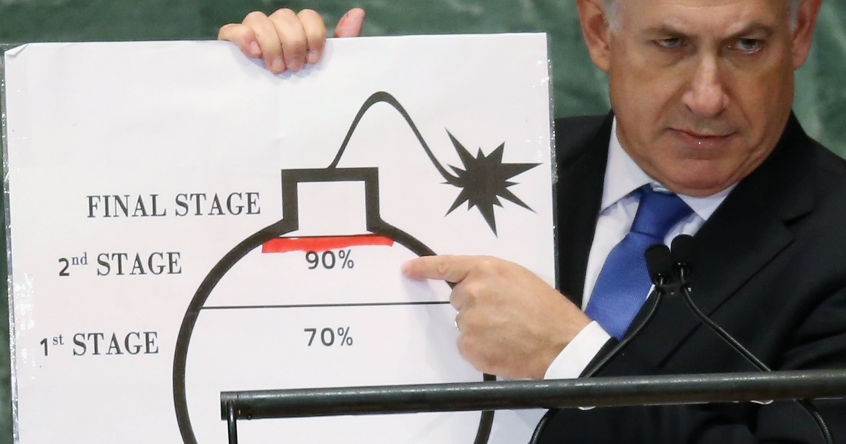 Israeli Prime Minister Benjamin Netanyahu points to a red line he drew on a graphic of a bomb while addressing the United Nations General Assembly on Sept. 27, 2012 in New York City.</p>