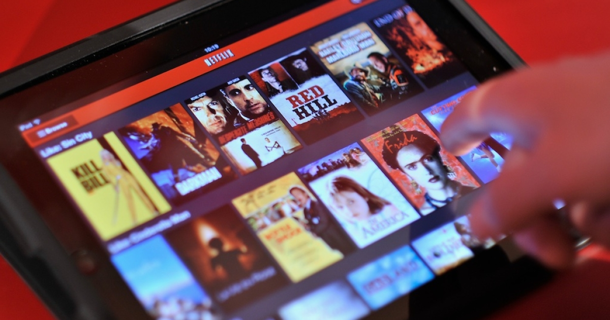 An Apple iPad is used to view Netflix during the Netflix UK launch in London, England on January 9, 2012.</p>