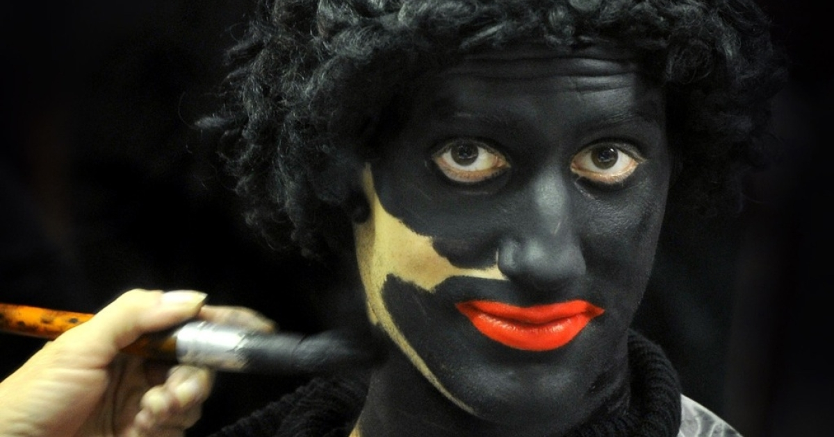 A person applies makeup on a man dressed as Black Peter prior to a celebration in a primary school, on December 3, 2010 in Soest, Netherlands.</p>