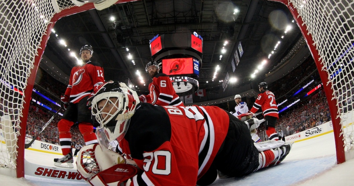 Martin Brodeur, No. 30 of the New Jersey Devils, looks on after making a save against the New York Rangers in Game Six of the Eastern Conference Final during the 2012 NHL Stanley Cup Playoffs at the Prudential Center on May 25, 2012 in Newark, New Jersey.</p>