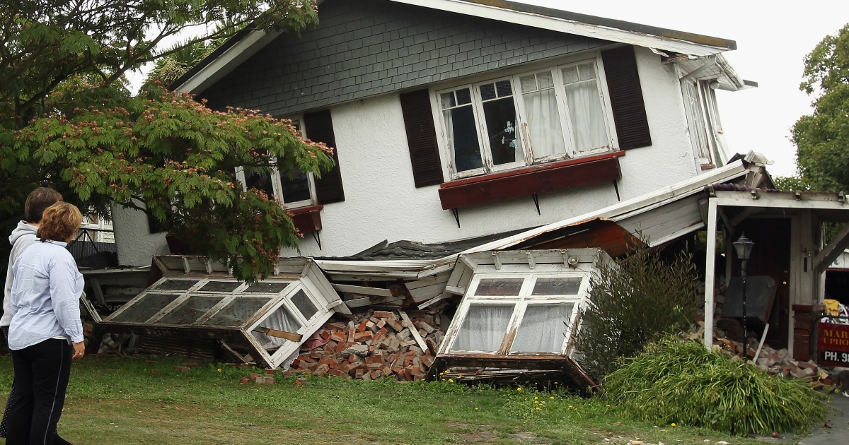 Neighbors check on a damaged house on Cashel Street on Feb. 25, 2011, in Christchurch, New Zealand. The death toll has risen to 113 and the hope for finding survivors is fading as rescuers search through debris for over 200 still missing following a 6.3 magnitude earthquake that struck the city on Tuesday.</p>