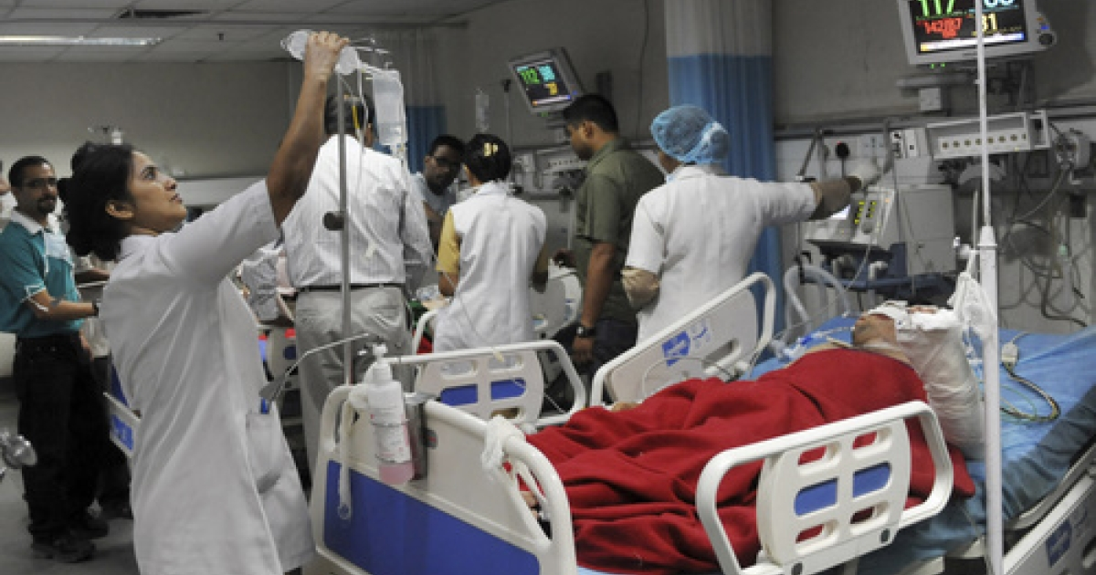 Indian nurses tend to patients at a government hospital in New Delhi on May 12, 2010.  May 12 is celebrated as International Nurses Day, honoured on the birthday Florence Nightingale, widely considered to be the founder of modern nursing.</p>