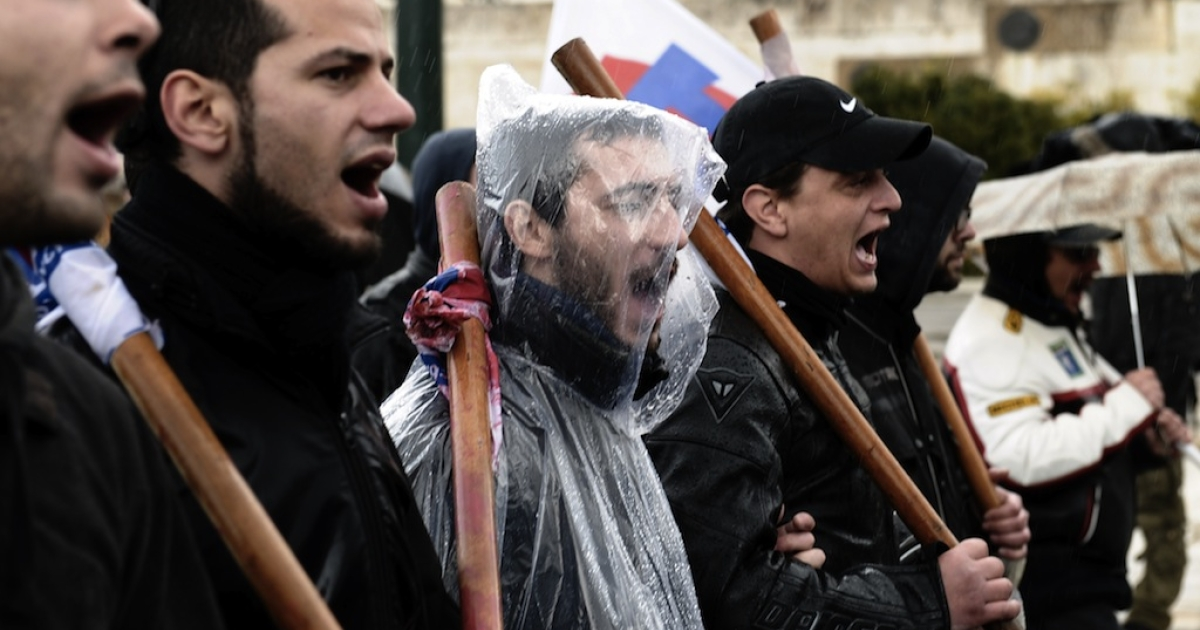 Protesters shout slogans during a 24-hour general strike in Athens on February 7, 2012. A general strike gripped Greece in protest against new austerity measures demanded with increasing urgency by the European Union as part of a debt rescue deal with banks.</p>