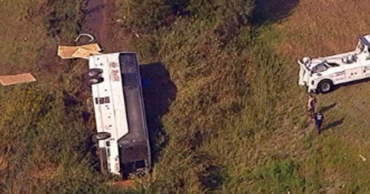 Emergency crews inspect a bus that slid down an embankment on October 6, 2012 in Wayne, NJ. Nearly two-dozen Canadian tourists were injured when their chartered bus ran off the road.</p>
