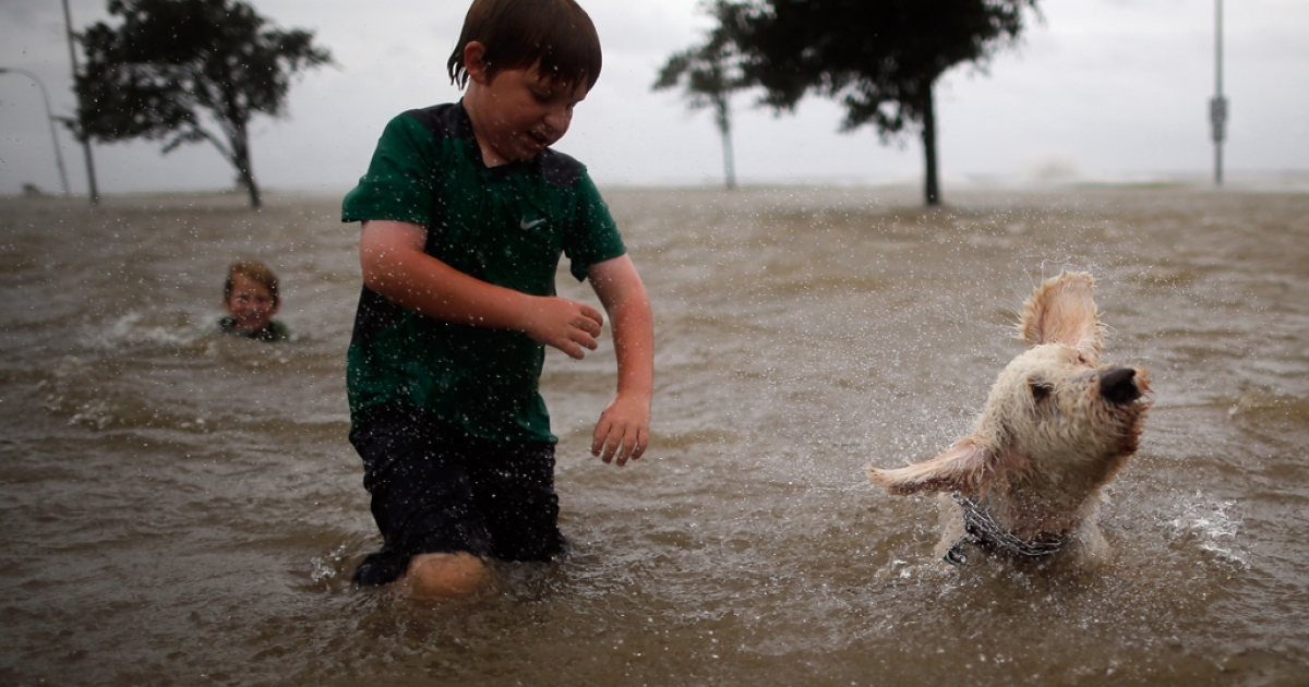 Joshua Keegan and his dog Scout swim in the rising water of Lake Pontchatrain as Hurricane Isaac approaches on August 28, 2012 in New Orleans, Louisiana. Isaac is heading north into the Mississippi and Ohio River Valleys drenching the drought-striken Midwest and causing flash flood warnings.</p>