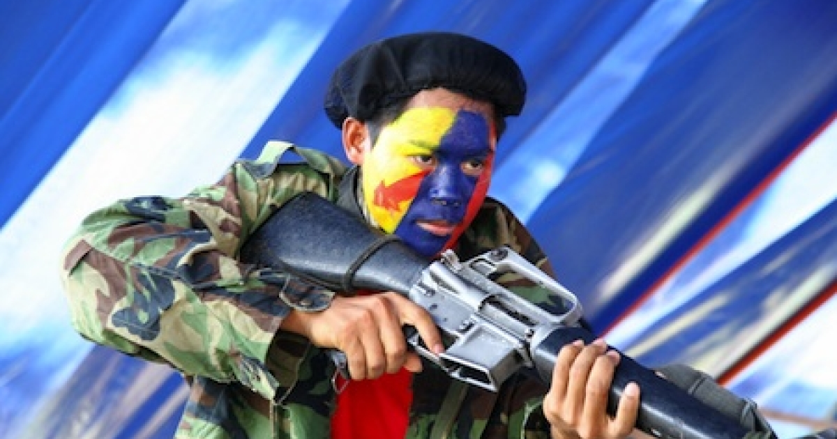 A New People's Army guerrilla performs a play during the 42nd anniversary of the Communist Party of the Philippines at a remote village in the southern island of Mindanao on December 26, 2010.</p>