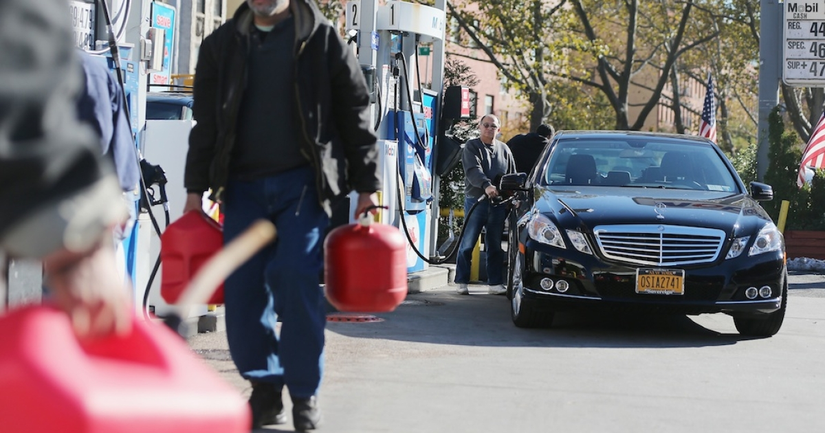 New Yorkers filling up in Manhattan on the first day of gas rationing on November 9, 2012.</p>