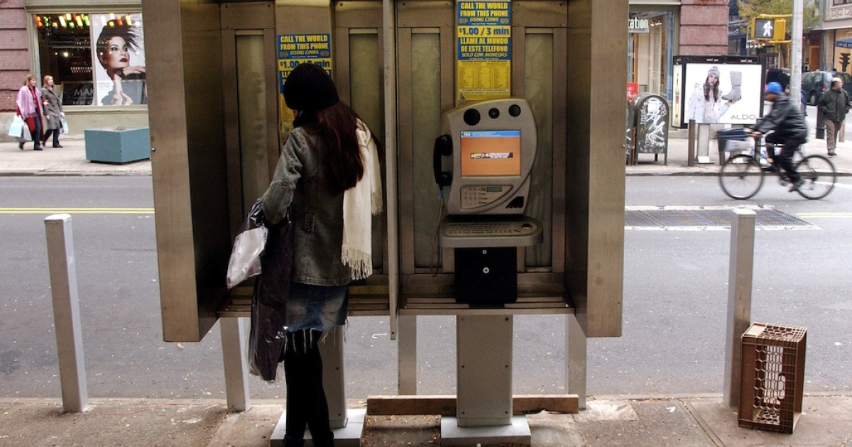 A woman speaks on a payphone on November 17, 2003 in New York CIty.</p>