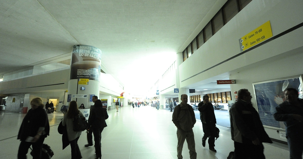 Passengers walk in the dark during a power outage at Newark Airport on Feb. 7, 2011, caused by an electrical failure at a switching station in Elizabeth, NJ.</p>