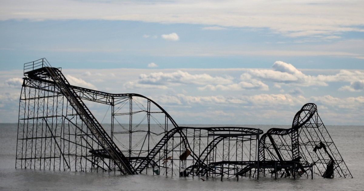 The Seaside Heights roller coaster sits destroyed in the middle of the ocean after Superstorm Sandy rolled through New Jersey. Some climate specialists believe a series of events caused by a record Arctic ice melt contributed to the severity and direction of the storm.</p>