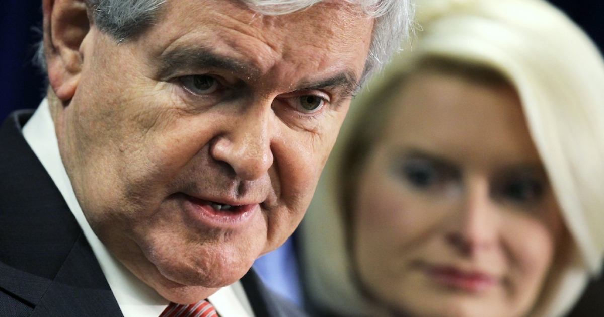 Republican presidential hopeful and former Speaker of the House Rep. Newt Gingrich (R-GA) speaks as his wife Callista Gingrich looks on during an education town hall January 4, 2012 in Concord, New Hampshire.</p>