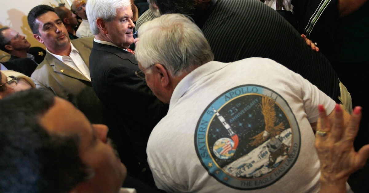 Republican presidential candidate and former Speaker of the House Newt Gingrich greets people during a Space Coast Town Hall Meeting on January 25, 2012 in Cocoa, Florida.</p>