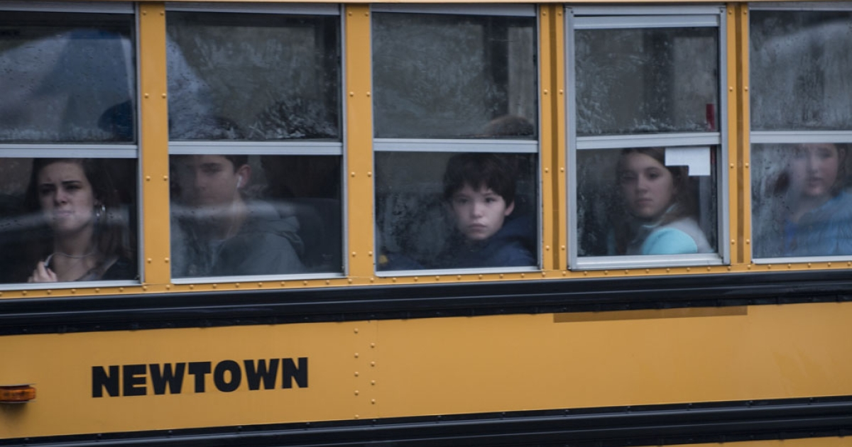 A school bus takes students to Newtown High School on December 18, 2012 in Connecticut. Students in Newtown, excluding Sandy Hook Elementary School, return to school for the first time since last Friday's shooting at Sandy Hook which took the live of 20 students and 6 adults.</p>