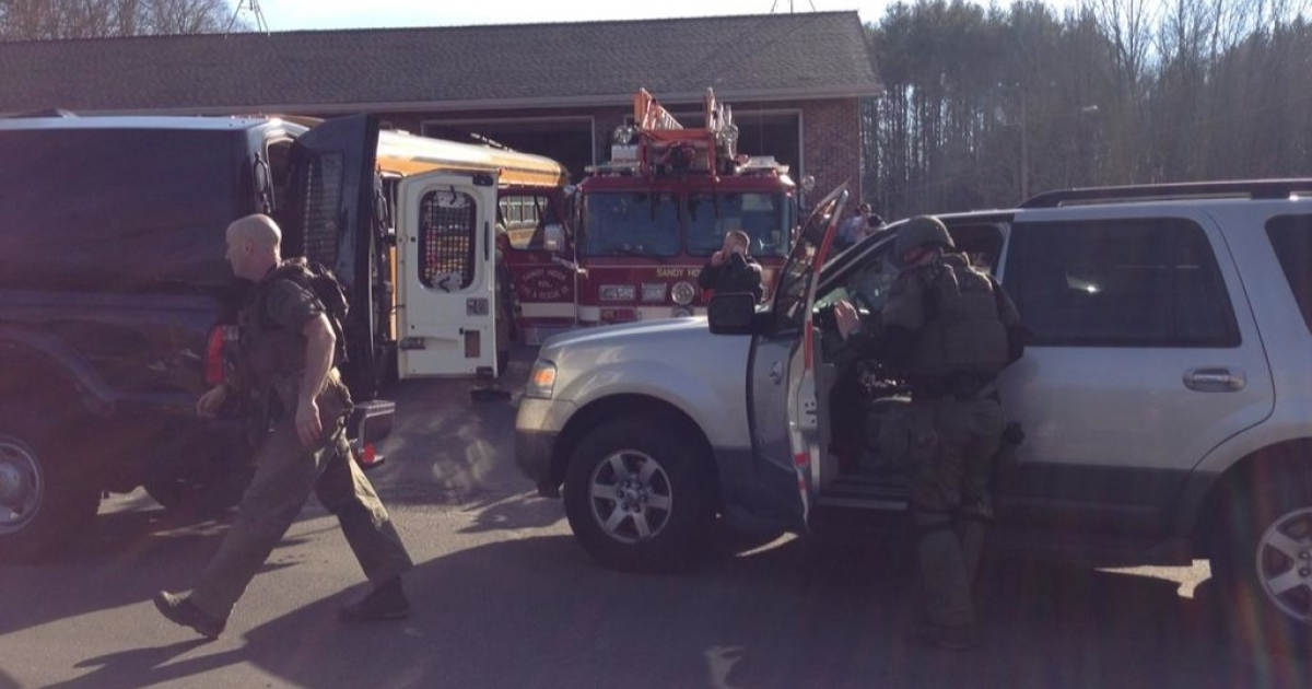 This photo uploaded to Twitter by NBC reporter Liz Dahlem shows Connecticut state police arriving at the scene of an elementary school shooting in Newtown.</p>