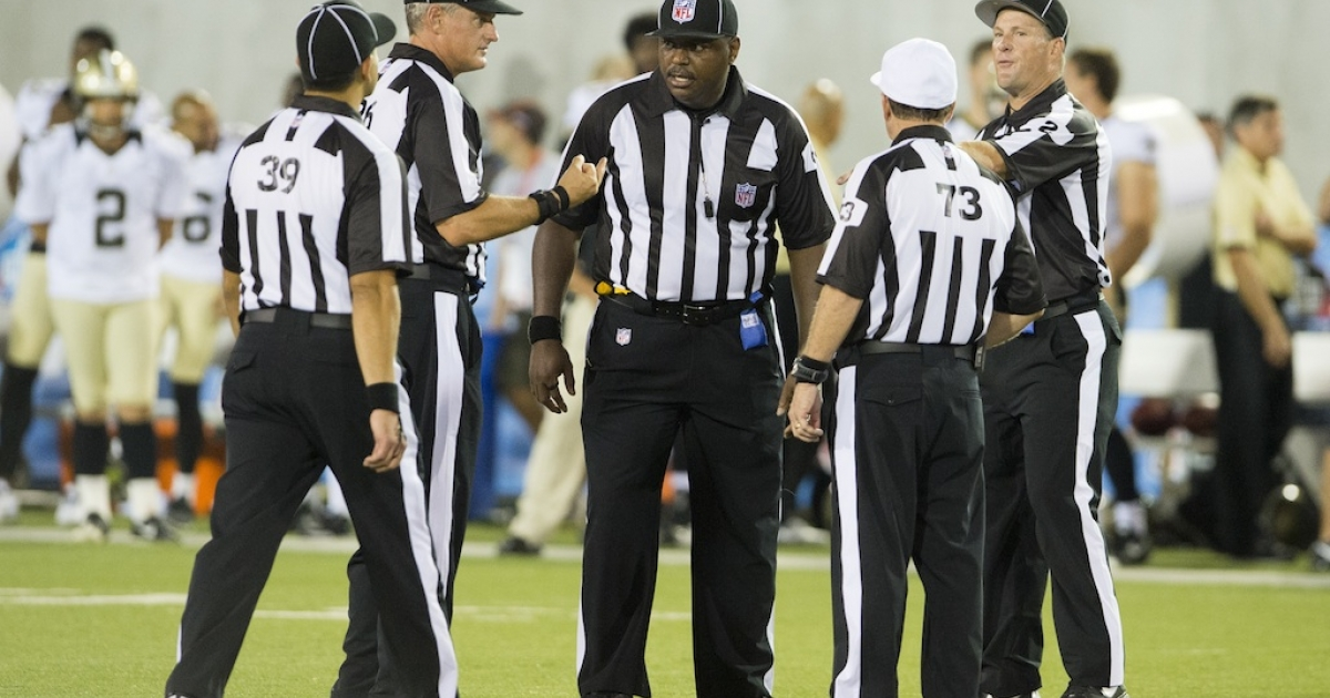 Game officials discuss the running of a play during the second half of the Pro Football Hall of Fame game at Fawcett Stadium on August 5, 2012 in Canton, Ohio. On Thursday, the first female ref will join their ranks.</p>