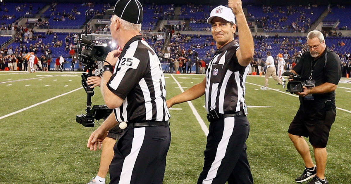 Game officials Bob Waggoner, left, and Gene Steratore take the field for the first time this season before the start of the Baltimore Ravens and Cleveland Browns game at M&amp;T Bank Stadium on September 27, 2012 in Baltimore, Maryland.</p>