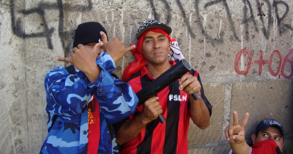 Defending Daniel: Members of the Sandinista Youth pose with homemade mortars. The ruling party's official youth group, which has been called on repeatedly in recent years as security thugs to put down opposition protests, has helped Ortega establish a one-party system in Nicaragua.</p>