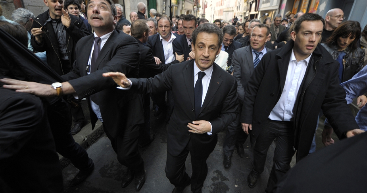 France's President and Union for a Popular Movement (UMP) party candidate for 2012 presidential election Nicolas Sarkozy (C) walks surrounded by bodyguards in a street of Bayonne during his campaign visit on March 01, 2012 in the Basque country, southwestern France.</p>