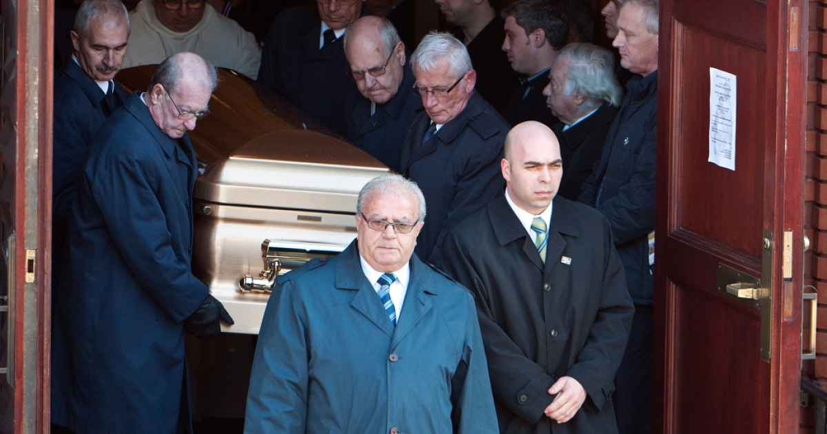 Pallbearers bring the casket of Mafia kingpin Nicolo Rizzuto Sr. out of the Notre-Dame-de-la-Defense church in Montreal, Canada Nov. 15, 2010 following his funeral. Secret police videos of the 86-year-old patriarch collecting money from various figures have linked him to several lucrative construction projects and revealed corruption within Montreal's government.</p>