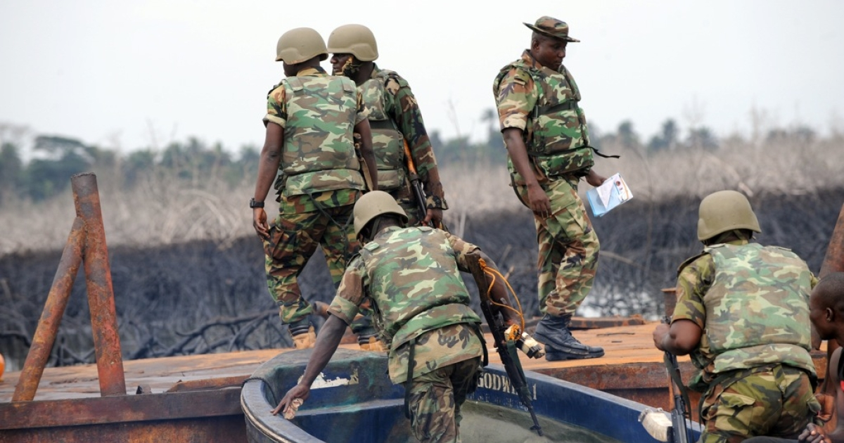 The Joint Take Force inspects a barge seized from oil thieves at Bodo waterways, Ogoniland in Rivers State on April 12, 2011.</p>