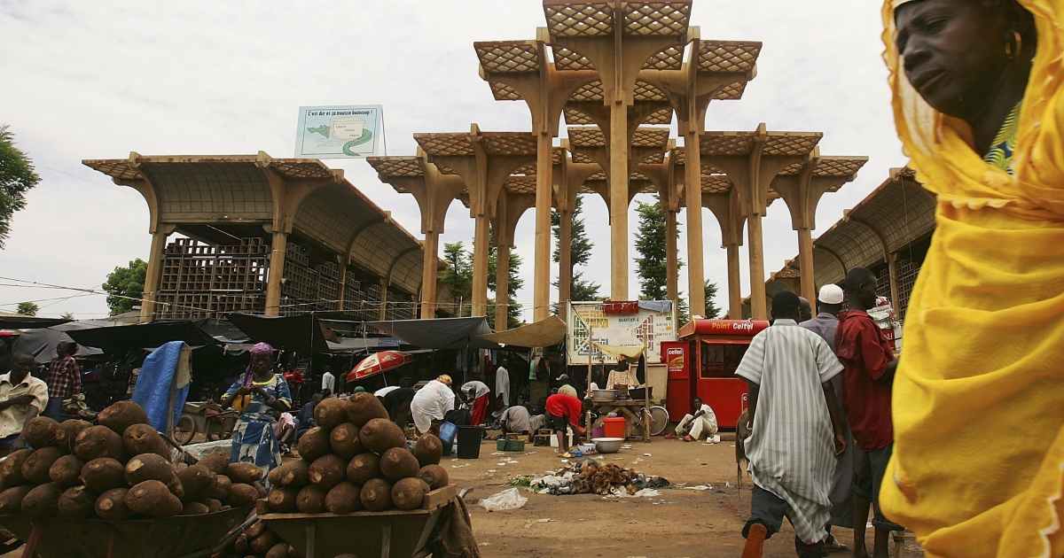 A  woman walks past the central marketplace on August 12, 2005 in Niger's capital, Niamey. Analysts say there is food available in Niger as the country faces its third food crisis in under a decade, but people are too poor to afford to buy it.</p>