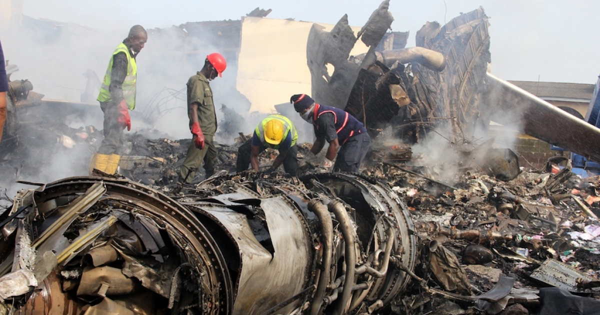 Rescuers and firefighters work among the wreckage from the plane that crashed on June 3, 2012, in Nigeria's largest city of Lagos, killing all of the 153 people on board, in the densely populated Toyin Area in Lagos.</p>