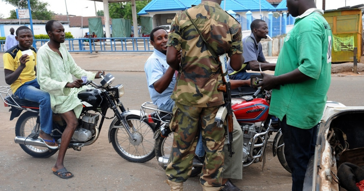 Nigeria has increased its security following a number of deadly attacks by Boko Haram, a group of Islamic extremists. Here a Nigerian soldier interrogates motorcyclists at a checkpoint in Kaduna State.</p>