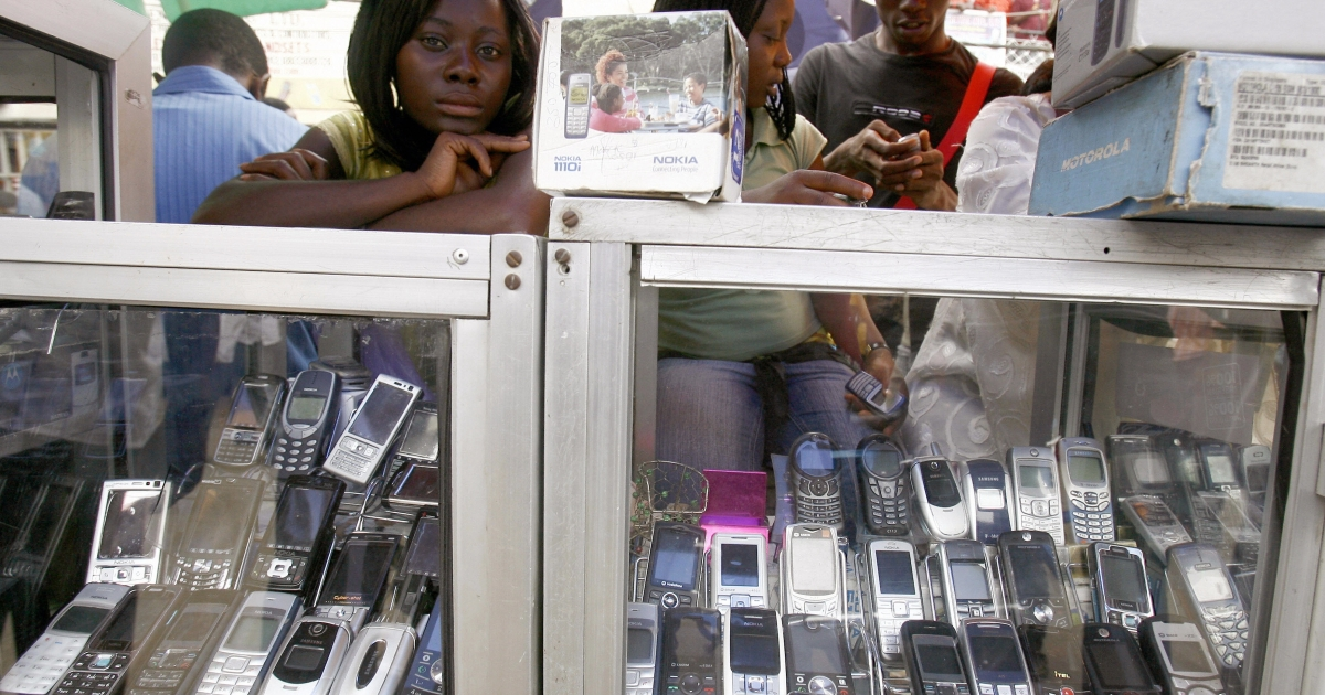 A mobile phone seller at the 'Computer village', a market for cellphones, second-hand computers and other electronic items in Lagos, Nigeria, on April 23, 2007.</p>