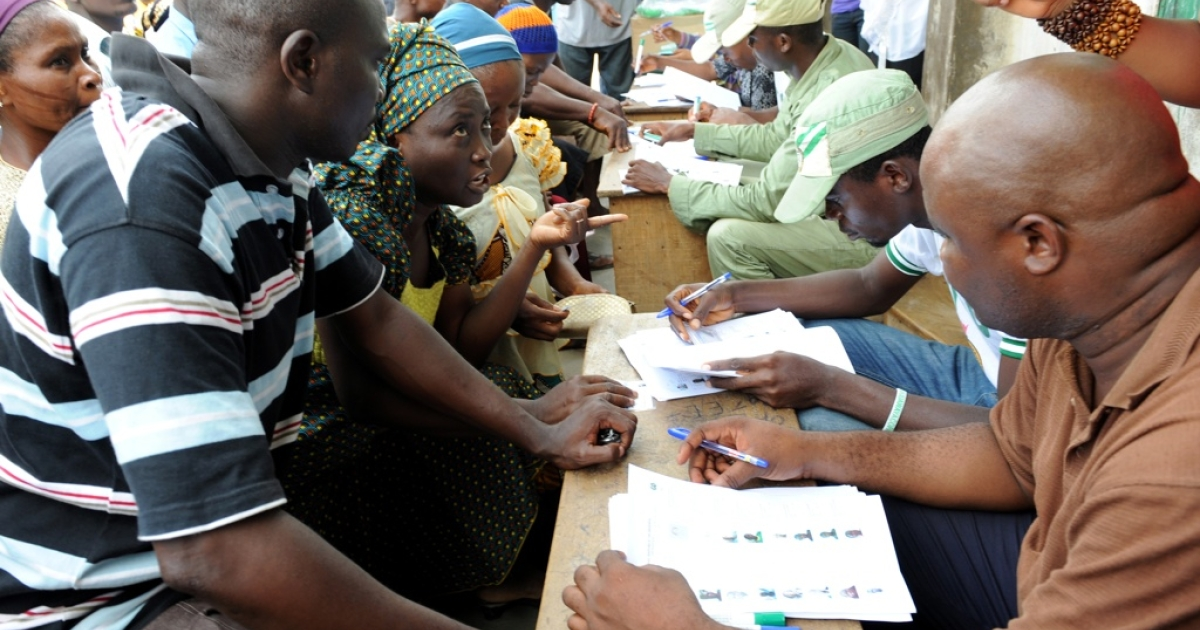 Nigerians register to vote on April 2, 2011. Later that day Nigerian officials postponed the parliamentary elections citing organizational problems.</p>