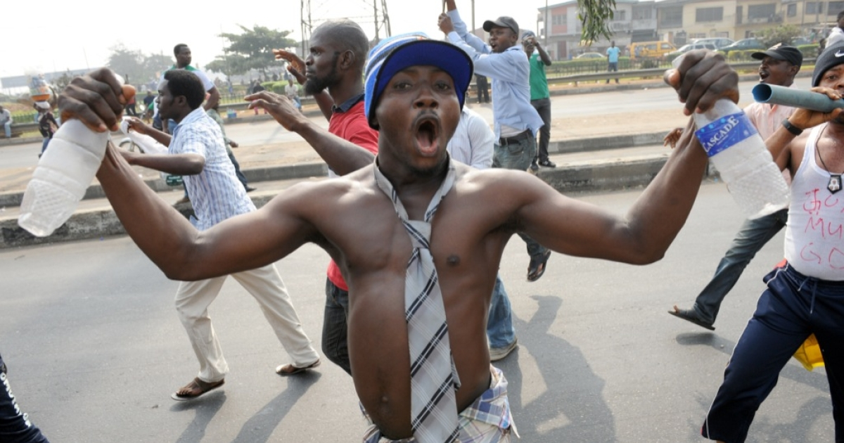 Protesters gesture and shout slogans on the fourth day of protest against the scrapping of oil subsidy at Gani Fawehinmi Park in Lagos on Jan. 12, 2012. Nigerian oil workers announced they would begin shutting down crude production as a nationwide strike and mass protests over soaring fuel prices pushed on.</p>