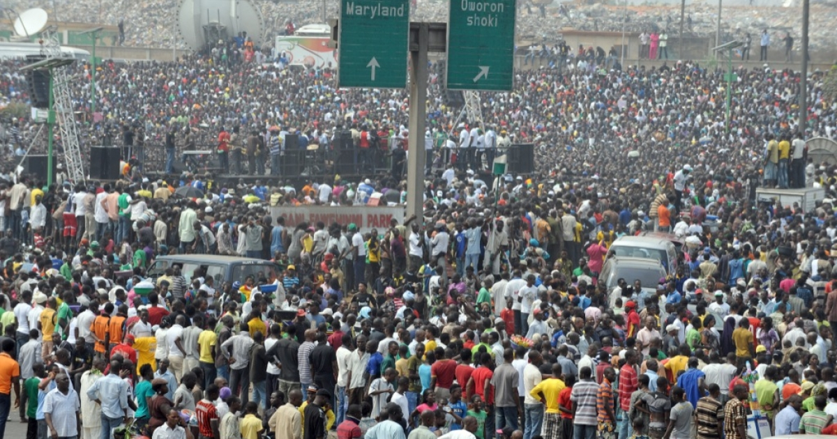 People gather during a protest against the scrapping of oil subsidy at Gani Fawehinmi Park, Ojota in Lagos on Jan. 12, 2012. Nigerian oil workers vowed Thursday to begin shutting down production of Africa's top crude exporter, piling intense pressure on the government ahead of talks on the fourth day of a nationwide strike.</p>