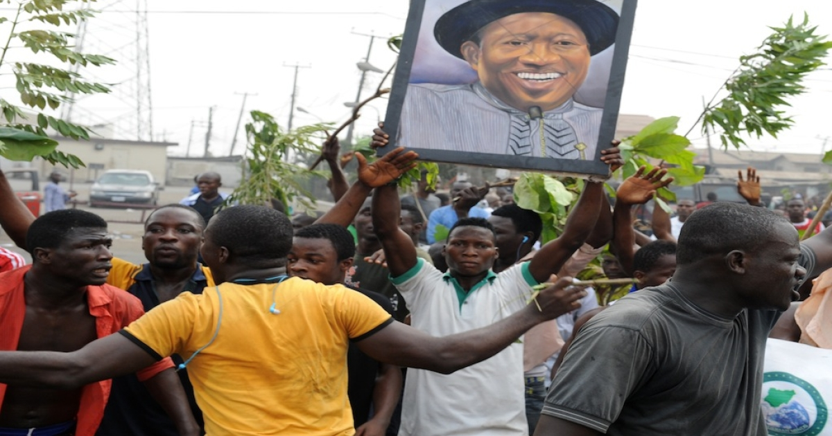 Protesters carry the portrait of Nigerian President Goodluck Jonathan during a protest against soaring petrol prices following government's decision to abolish decades-old fuel subsidies, on Jan. 9, 2012 in Lagos. One protester was shot dead in Nigeria's commercial capital Lagos during the national strike over fuel prices, a union leader said.</p>
