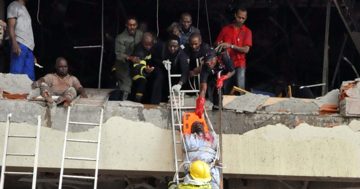 Rescue workers evacuate a wounded man from the UN building in Nigeria's capital city, Abuja, on Aug. 26, 2011, after a bomb rocked the building.</p>