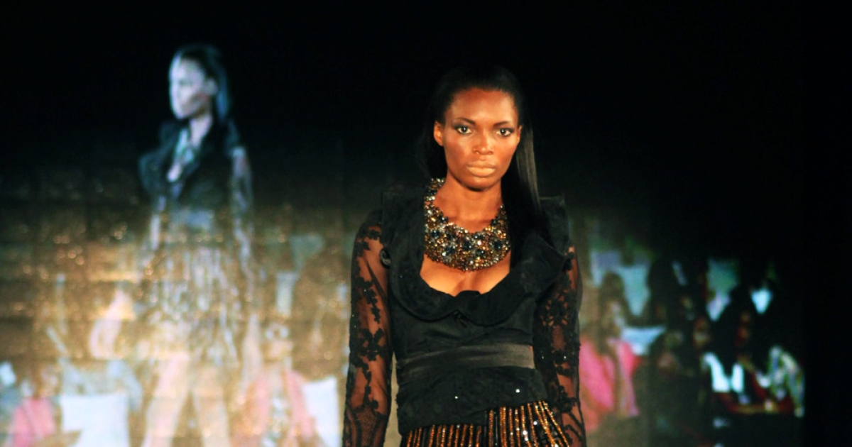 A model displays clothes from The Collection of Toju Foyeh at The Arise Magazine Fashion Week at Victoria Island in Lagos late on Mar. 8, 2012.</p>