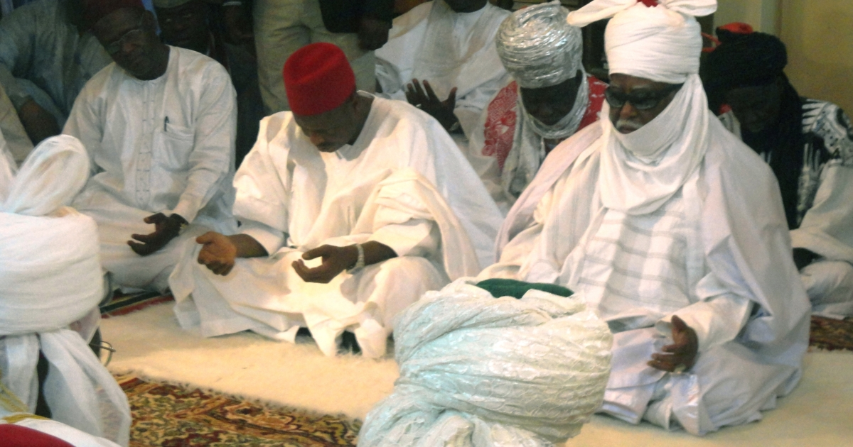 The governor of Kano state Rabiu Musa Kwankwaso (2nd L) and the emir of Kano Ado Bayero (R) pray in the central mosque in the northern Nigerian city of Kano on January 23, 2012 after a wave of attacks claimed by Islamists left more than 185 dead and raised fresh fears of civil unrest.  Among the dead was Nigerian television journalist Enenche Akogwu.</p>